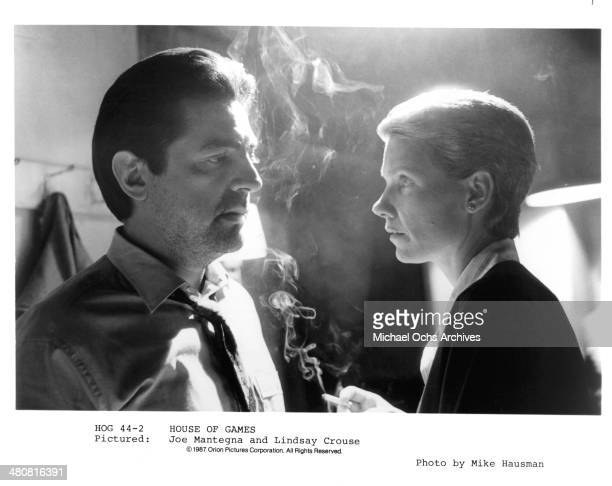 Actor Joe Mantegna and actress Lindsay Crouse in a scene from the Orion Picture movie House of Games circa 1987