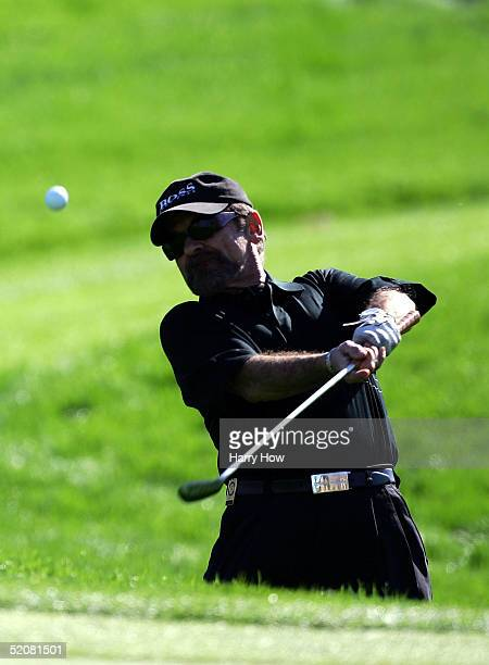 Actor Joe Pesci hits out of a bunker on the third hole during the fourth round of the Bob Hope Classic at PGA West Palmer Course on January 29 2005...
