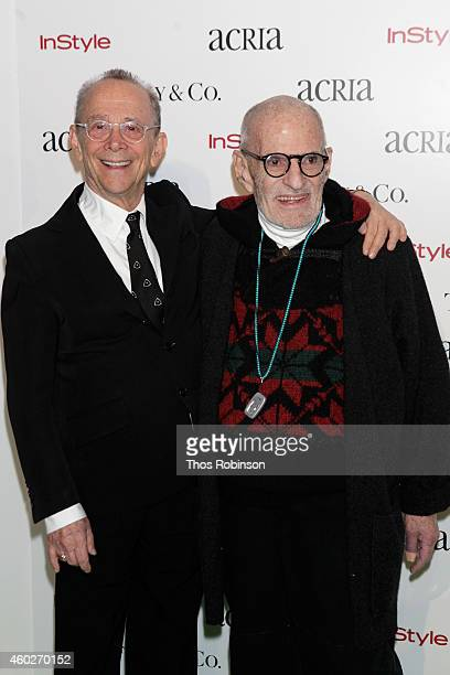 Actor Joel Grey and playwright Larry Kramer attend the 19th Annual ACRIA Holiday Dinner at Skylight Modern on December 10 2014 in New York City