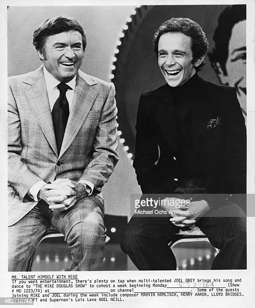 Actor Joel Grey joins host Mike Douglas in December 1974
