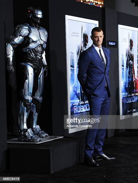 "Actor Joel Kinnaman arrives at the Los Angeles premiere of ""Robocop"" at the TCL Chinese Theatre on February 10, 2014 in Hollywood, California."
