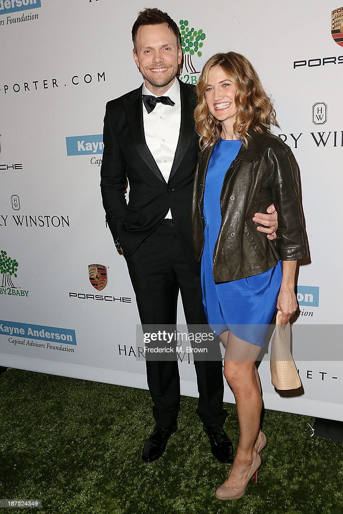 Actor Joel McHale (L) and his guest attend the Second Annual Baby2Baby Gala at the Book Bindery on November 9, 2013 in Culver City, California.