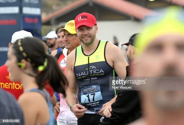 Actor Joel McHale participates in the Nautica Malibu Triathlon at Zuma Beach on September 17 2017 in Malibu California