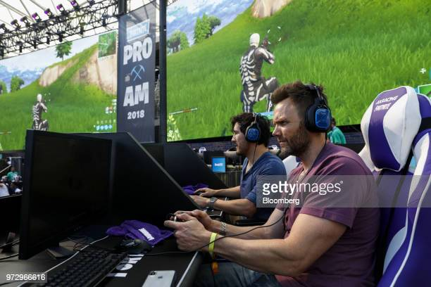 Actor Joel McHale right plays in the Epic Games Inc Fortnite Battle Royale Celebrity Pro Am on the sidelines of the E3 Electronic Entertainment Expo...