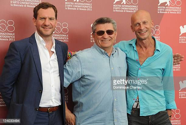 "Actor Johannes Zeiler, director Alexander Sokurov and actor Anton Adasinskiy attend the ""Faust"" Photocall during the 68th Venice International Film..."