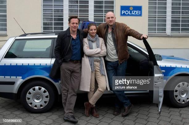 Actor Johannes Zirner as Bjoern Delbrueck actress Yvonne Catterfeld as Commissar Viola Delbrueck and actor Goetz Schubert as Commissar Burkhard...