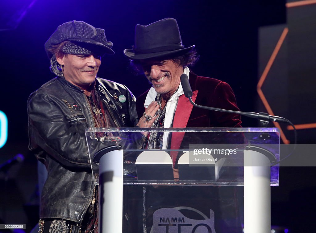 Actor Johhny Depp and musician Joe Perry perform onstage at the TEC Awards during NAMM Show 2017 at the Anaheim Hilton on January 21, 2017 in Anaheim, California.