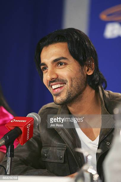 Actor John Abraham laughs at the press conference for the film 'Water' on September 9 2005 in Toronto Canada