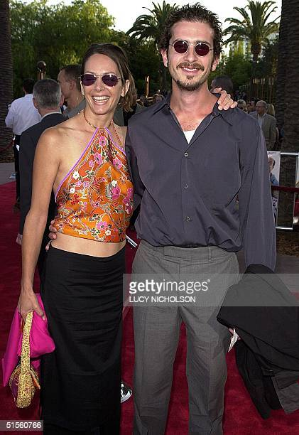 US actor John Ales arrives at the premiere of his new film Nutty Professor II with his girlfriend Wendy Gazelle in Universal City 24 July 2000 The...