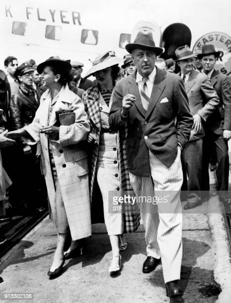 US actor John Barrymore accompanied by US actress Elaine Barrie and her mother Edna Barrie arrives at Newark Liberty International Airport in Newark...