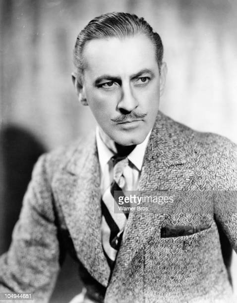 Actor John Barrymore wearing a tweed coat and a serious expression in a promotional portrait for an unidentified film circa 1920