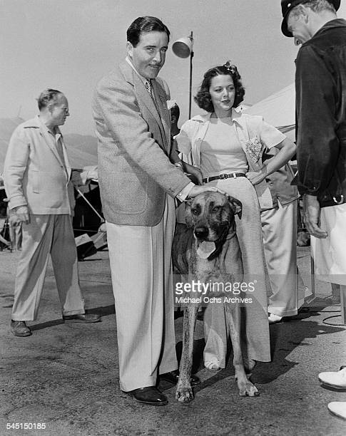 Actor John Boles and actress Carol Hughes attend an event with a dog in Los Angeles California