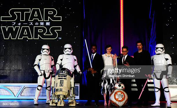 Actor John Boyega actress Daisy Ridley, director J.J. Abrams and actor Adam Driver attend the fan event for 'Star Wars: The Force Awakens' at...