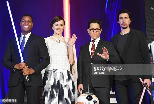 Actor John Boyega actress Daisy Ridley director JJ Abrams and actor Adam Driver attend the fan event for 'Star Wars The Force Awakens' at Roppongi...