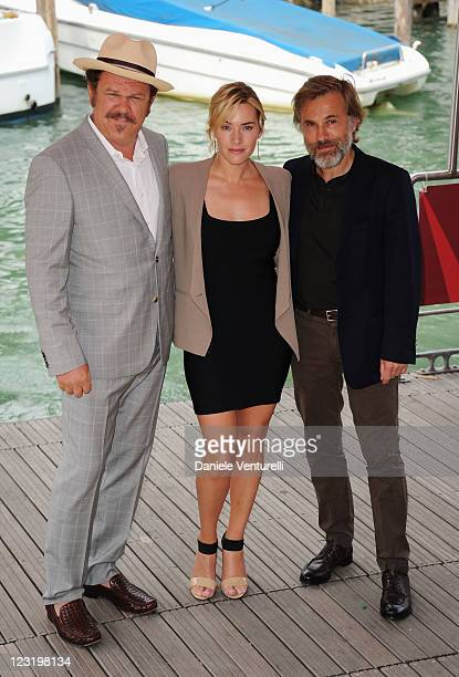 Actor John C Reilly actress Kate Winslet and actor Christoph Waltz arrive ahead of the Carnage Photocall during the 68th Venice International Film...