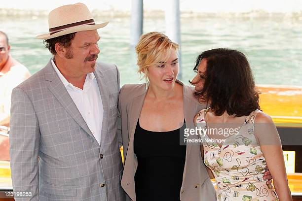 Actor John C Reilly actress Kate Winslet and writerYasmina Reza arrive at the Carnage photocall during the 68th Venice Film Festival at the Palazzo...
