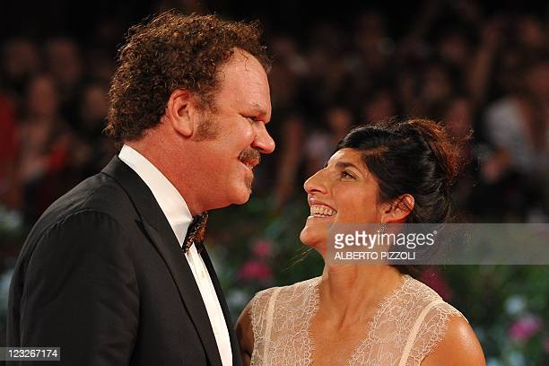 Actor John C Reilly and his wife Alison arrive for the screening of Carnage at the 68th Venice Film Festival on September 1 2011at Venice Lido...