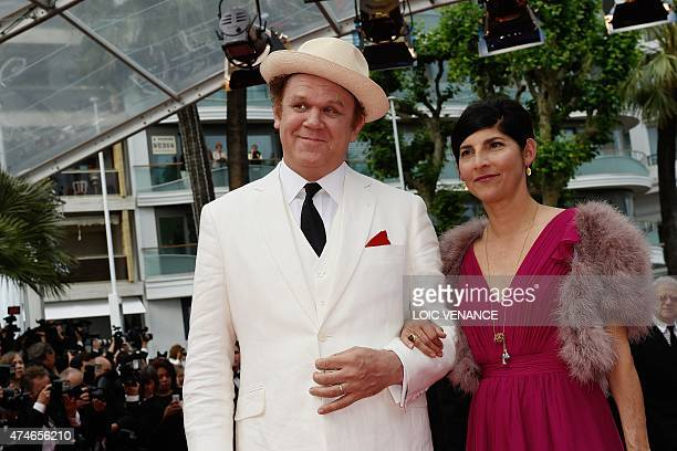 US actor John C Reilly and his wife Alison Dickey pose as they arrive for the closing ceremony of the 68th Cannes Film Festival in Cannes...