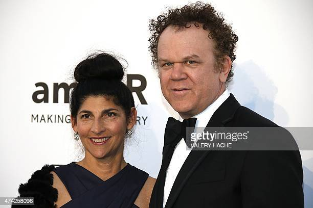 US actor John C Reilly and his wife producer Alison Dickey pose as they arrive for the amfAR 22st Annual Cinema Against AIDS during the 68th Cannes...