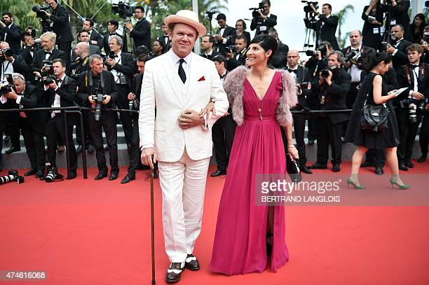 US actor John C Reilly and his wife US producer Alison Dickey pose as they arrive for the closing ceremony of the 68th Cannes Film Festival in Cannes...