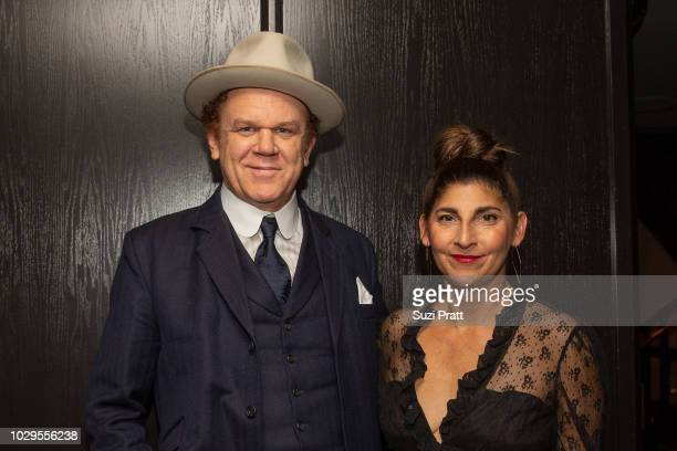 Actor John C. Reilly and producer Alison Dickey pose for a photo at Sony Pictures Classics TIFF Celebration Dinner at Morton's on September 8, 2018...
