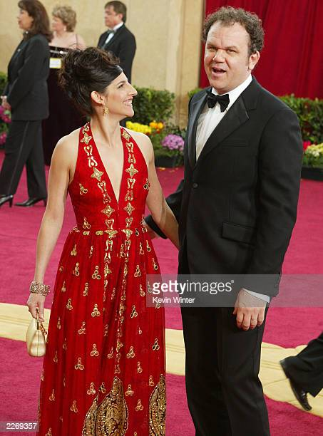 Actor John C Reilly and wife Alison attend the 75th Annual Academy Awards at the Kodak Theater on March 23 2003 in Hollywood California