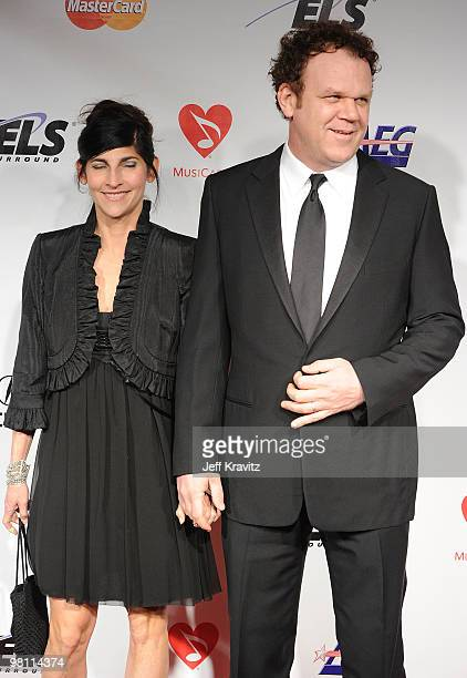Actor John C Reilly and wife Alison Dickey arrive at 2010 MusiCares Person Of The Year Tribute To Neil Young at the Los Angeles Convention Center on...