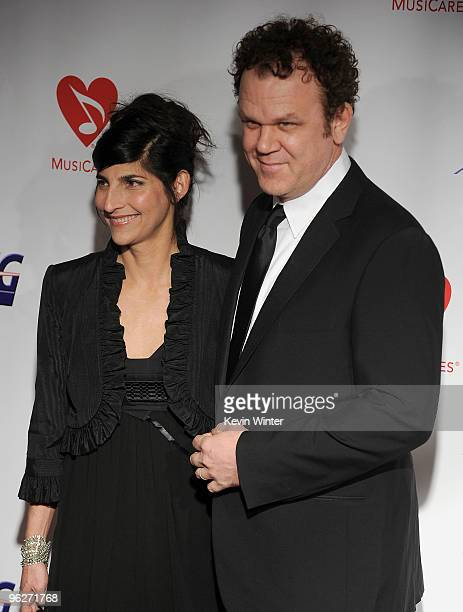 Actor John C Reilly and wife Alison Dickey arrive at the 2010 MusiCares Person Of The Year Tribute To Neil Young at the Los Angeles Convention Center...