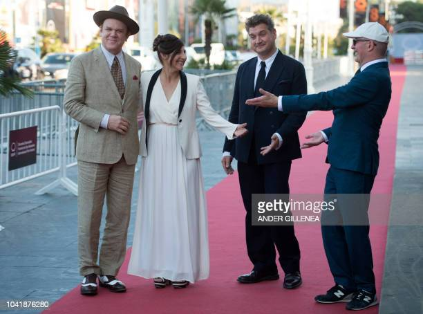 US actor John C Reilly his wife Alison Dickey French guionist Thomas Bidegain and French director Jacques Audiard pose on the Red Carpet before the...