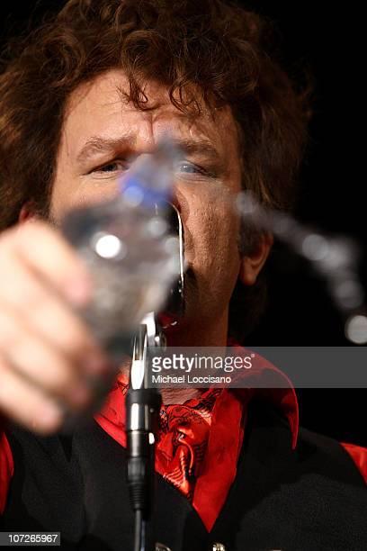 Actor John C Reilly throws water at the crowd during his performance as Dewey Cox and The Hard Walkers at The Knitting Factory in New York City on...
