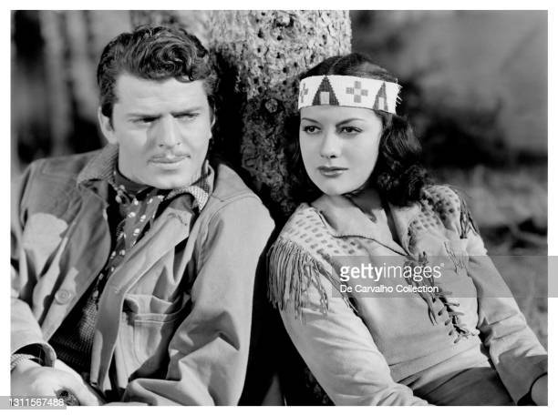 Actor John Carroll as 'Michael Vance' and Actress Movita Castaneda as 'Towana' in a scene from the movie 'Cry Wolf' United States.