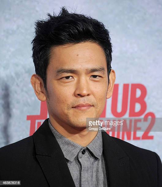 Actor John Cho arrives at the Los Angeles premiere of Hot Tub Time Machine 2 at Regency Village Theatre on February 18 2015 in Westwood California