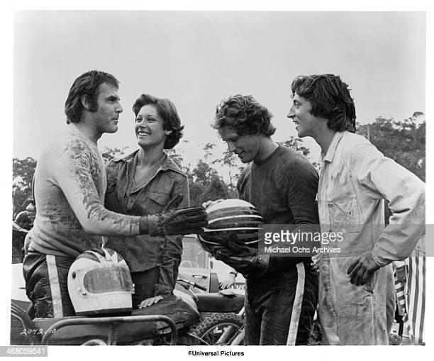 "Actor John Clayton, actress Wendy Hughes, actors Ben Murphy and John Derum on set of the movie ""Sidecar Racers"" circa 1975."