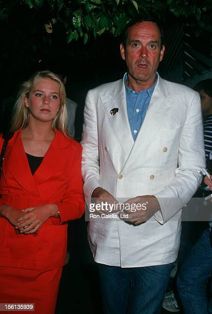 Actor John Cleese and daughter Camilla Cleese being photographed on July 15 1988 at Spago Restaurant in West Hollywood California