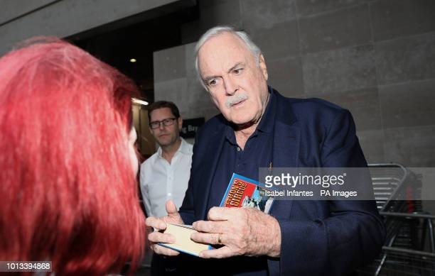 Actor John Cleese signs autographs to fans outside BBC Broadcasting House in London after appearing on The One Show with his daughter Camilla Cleese