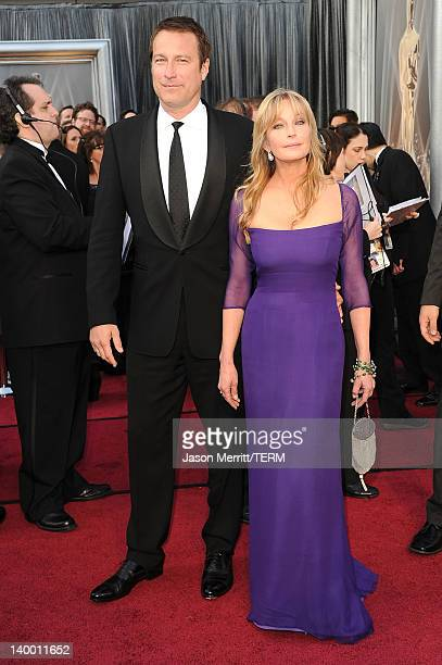 Actor John Corbett and actress Bo Derek arrives at the 84th Annual Academy Awards held at the Hollywood & Highland Center on February 26, 2012 in...