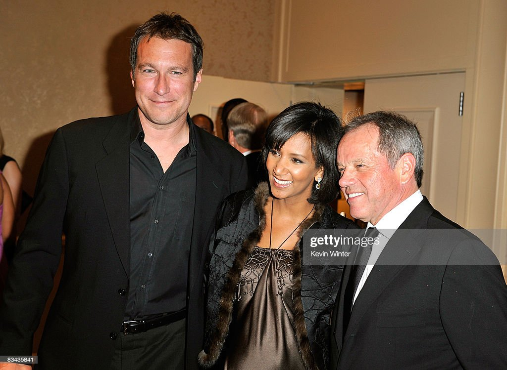 Actor John Corbett, Gelila Assefa, and chef Wolfgang Puck pose during the cocktail reception at the 30th anniversary Carousel of Hope Ball to benefit the Barbara Davis center for childhood diabetes held at the Beverly Hilton Hotel on October 25, 2008 in Beverly Hills, California.