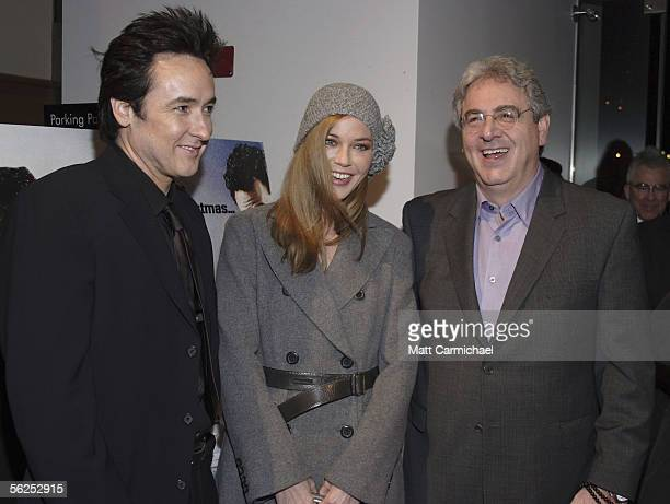 Actor John Cusack actress Connie Nielsen and Director Harold Ramis attend the Focus Features premiere of The Ice Harvest November 21 2005 in Chicago...