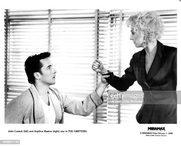 Actor John Cusack and actress Anjelica Huston on set of the movie 'The Grifters ' circa 1990