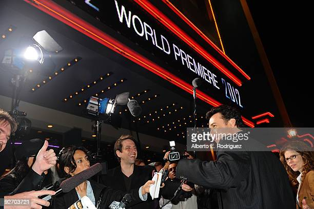 Actor John Cusack arrives at the premiere of Columbia Pictures' 2012 at the Regal Cinemas LA live on November 3 2009 in Los Angeles California