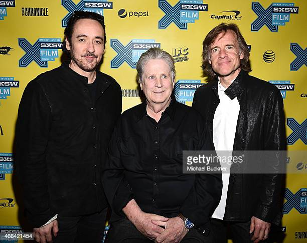 Actor John Cusack musician Brian Wilson and director Bill Pohlad arrive at the premiere of Love Mercy during the 2015 SXSW Music Film Interactive...
