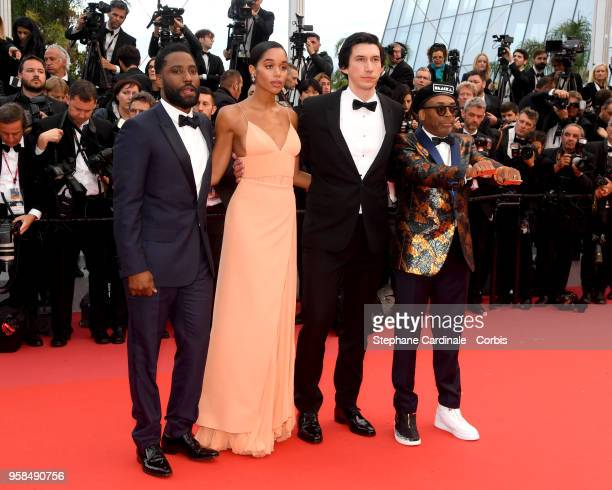 Actor John David Washington actress Laura Harrier actor Adam Driver and director Spike Lee wearing knuckle rings with love and hate on them as they...