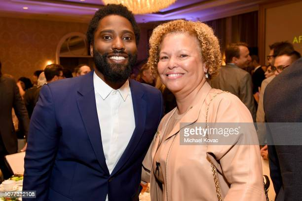 Actor John David Washington and Debra Lee attend the 19th Annual AFI Awards at Four Seasons Hotel Los Angeles at Beverly Hills on January 4 2019 in...