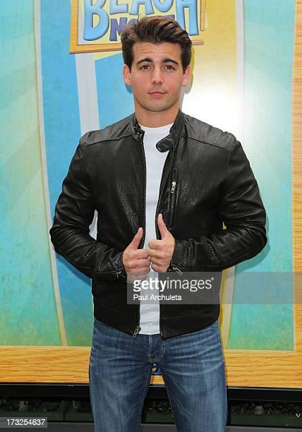 "Actor John Deluca attends the cast reunion of ""Teen Beach Movie"" for movie night at Walt Disney Studios on July 10, 2013 in Burbank, California."