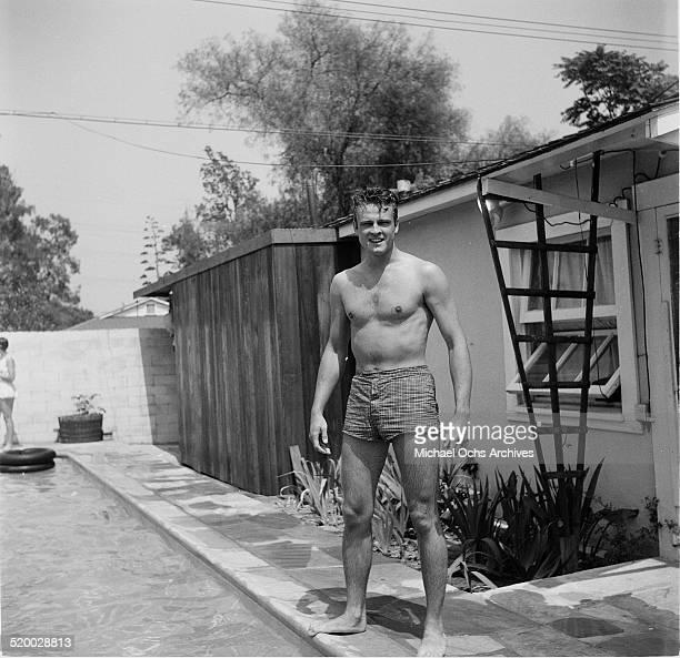 Actor John Ericson attends actress Debbie Reynolds pool party in Los AngelesCA