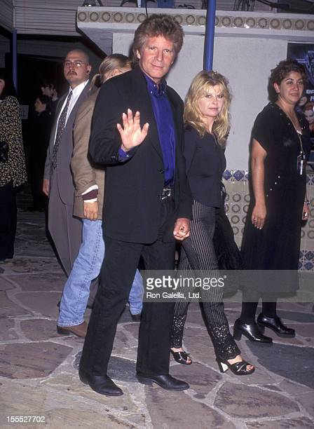 Actor John Fogerty and wife Julie Lebiedzinski attend the Batman Robin Westwood Premiere on June 12 1997 at Mann Village Theatre in Westwood...