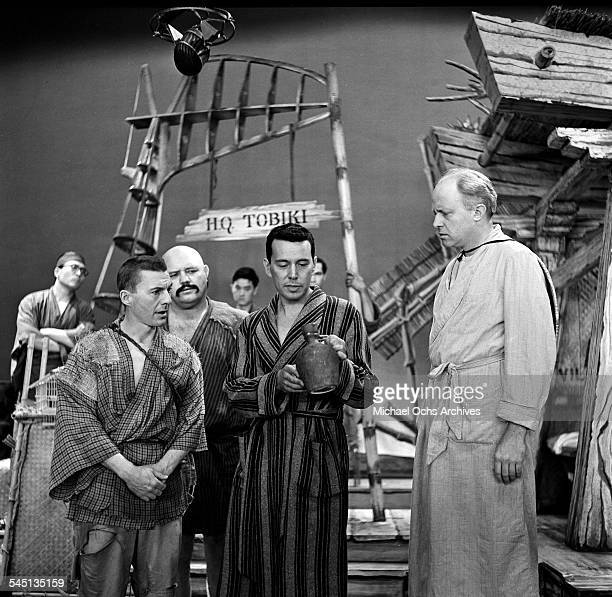 Actor John Forsythe performs a scene from 'Teahouse of the August Moon' on the 'Toast of the Town' show hosted by Ed Sullivan at the Maxine Elliott...