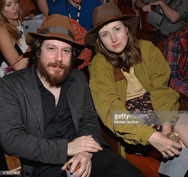 Actor John Gallagher and actress Kate Lyn Sheil pose in the audience during the 2014 SXSW Film Awards at the Paramount Theatre on March 11 2014 in...