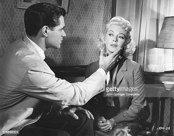 Actor John Gavin plays the part of photographer Steve Archer who admires the photogenic qualities of aspiring actress Lora Meredith played by actress...
