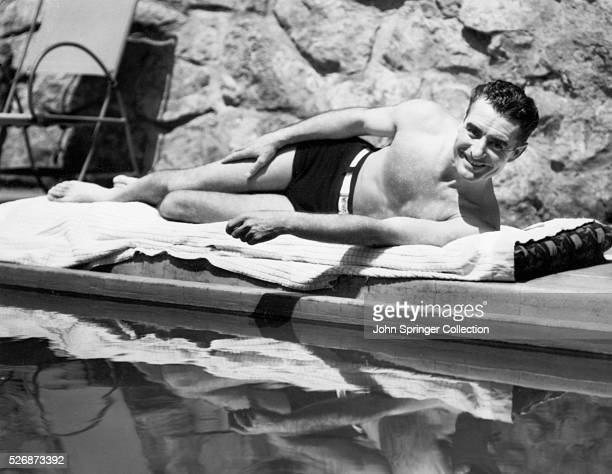 Actor John Gilbert Sunbathing
